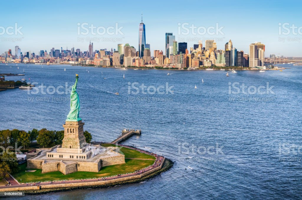 aerial view of the statue of liberty in front of Manhattan skyline. New York. USA stock photo