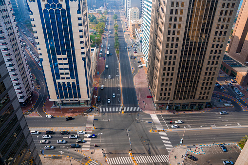 istock Aerial view of the streets of Abu Dhabi surrounded by skyscrapers. 1201833237