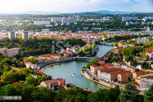 istock Aerial view of the suburbs of Lyon French city along Saone river with some residential buidings and boats sailing 1263913610