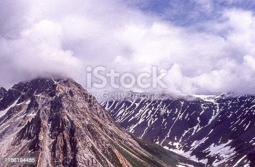 Aerial view of the top of Mt. Denali, seen in the distance hidden by clouds.  Taken in Denali National Park, Alaska, USA.