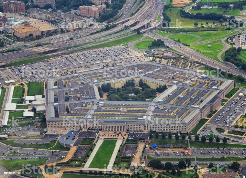 Aerial view of the United States Pentagon, the Department of Defense headquarters in Arlington, Virginia, near Washington DC, with I-395 freeway and the Air Force Memorial and Arlington Cemetery nearby. stock photo