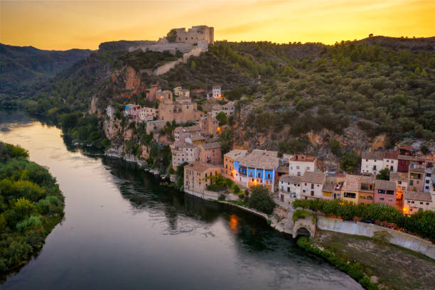 Aerial view of the village of Miravet at the Ebro river in Tarragona at sunset, Catalonia. Spain stock photo