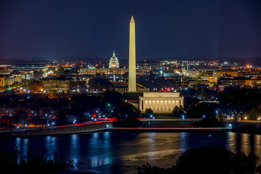 Long Exposure picture of illuminated Washington DC at night with the US. Capitol, Washington Monument and the Lincoln Memorial visible