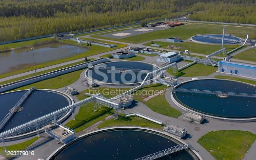 Aerial view of the wastewater treatment plant. Pumping station and drinking water supply. Industrial and urban water treatment for a big city. Round sedimentation tanks.