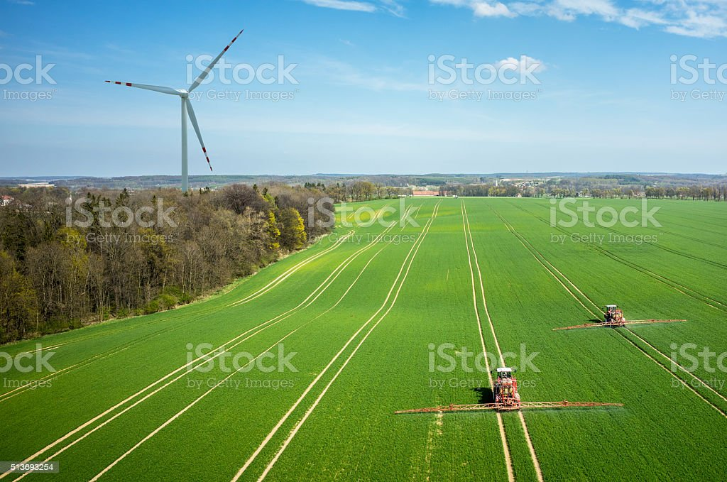 Aerial view of the windmill and the tractors stock photo