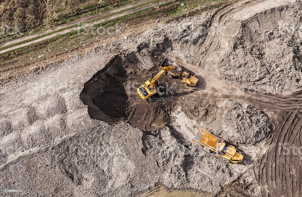 Aerial view of the working earth mover stock photo