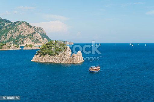 1066331604istockphoto aerial view of tourist boat and rocky islands 501605150