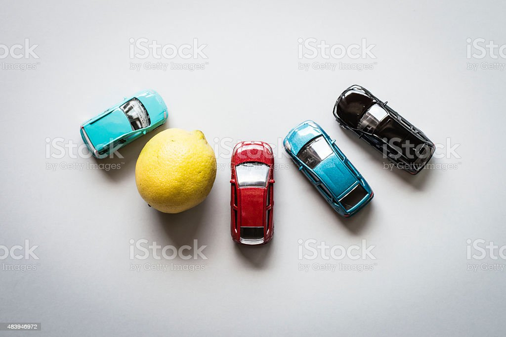 Aerial view of toys cars and a lemon in circle stock photo