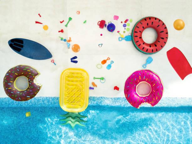 aerial view of toys in the pool - brinquedos na piscina imagens e fotografias de stock