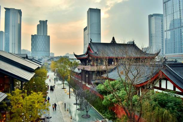 aerial view of traditional chinese temples in chengdu's modern financial center (downtown) - chengdu, china - historic vs new stock photos and pictures