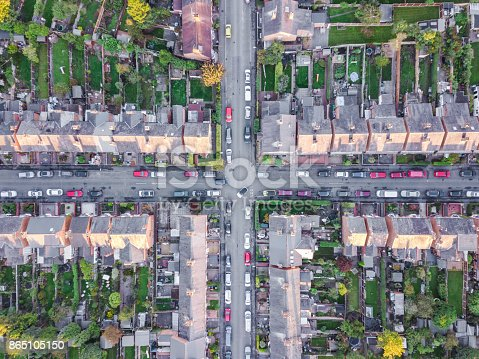 Old fashioned British suburb cross roads taken be an drone from the air.