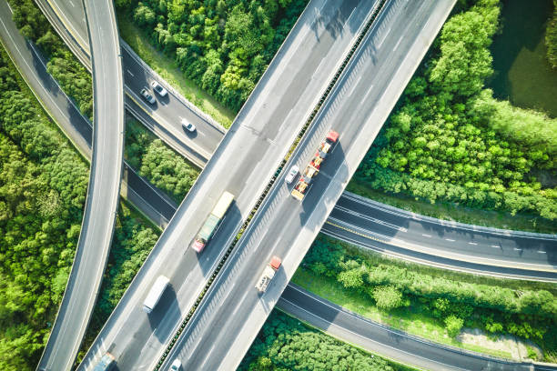 aerial view of traffic and overpasses in spring - highway stock photos and pictures