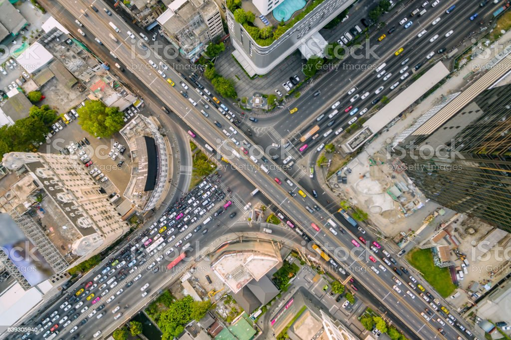 aerial view of traffic junction and transportation road in city, stock photo