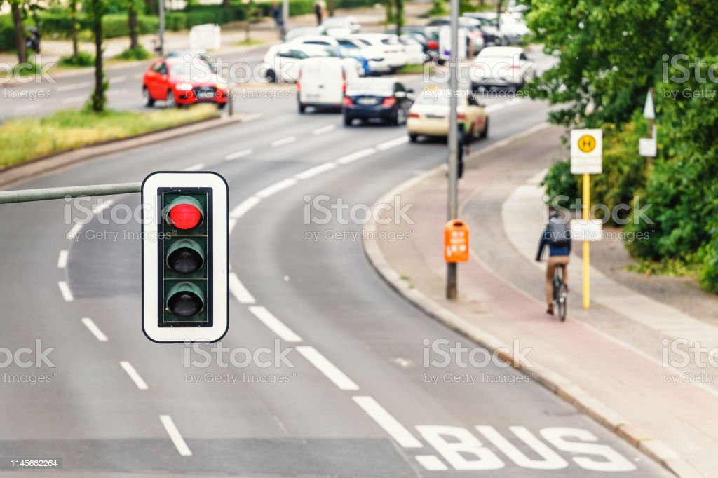 Aerial view of Traffic light above busy road in the city with...