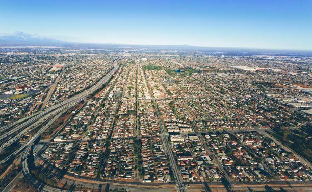 aerial view of traffic on a highway in la - urban sprawl stock photos and pictures