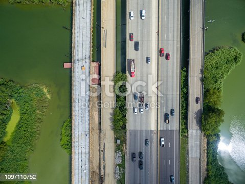 94502198istockphoto Aerial view of traffic on a major Texas freeway. 1097110752