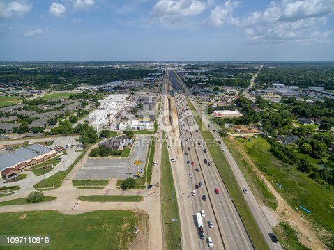 94502198istockphoto Aerial view of traffic on a major Texas freeway. 1097110816
