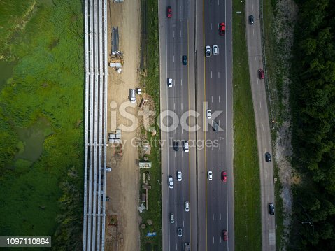 94502198istockphoto Aerial view of traffic on a major Texas freeway. 1097110864