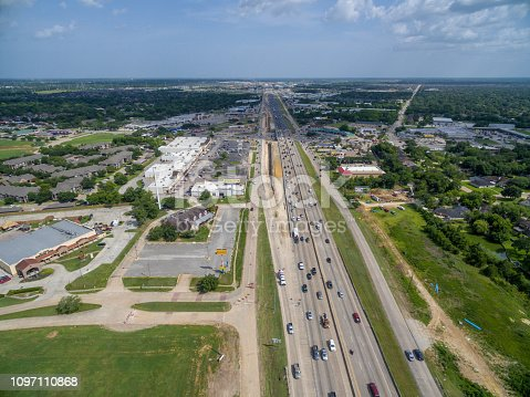 94502198istockphoto Aerial view of traffic on a major Texas freeway. 1097110868