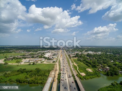94502198istockphoto Aerial view of traffic on a major Texas freeway. 1097111178