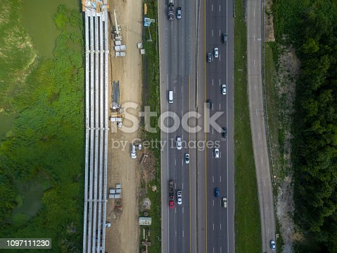 94502198istockphoto Aerial view of traffic on a major Texas freeway. 1097111230