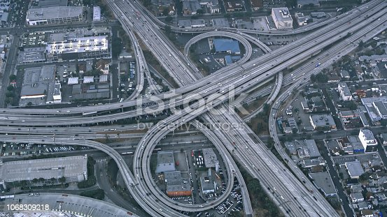 94502198istockphoto Aerial view of traffic on the massive highway intersection in Los Angeles, California 1068309218