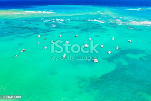 1127346848 istock photo Aerial view of tropical caribbean sea with yachts and boats on blue turquoise ocean. Dominican Republic 1226058199