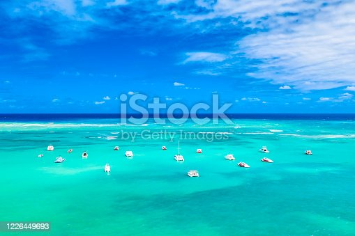 1127346848 istock photo Aerial view of tropical caribbean sea with yachts and boats on blue turquoise ocean Dominican Republic. Beautiful blue sky 1226449693