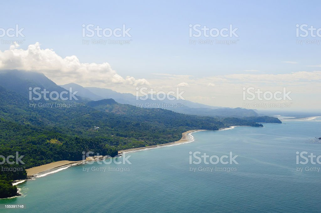 Aerial view of tropical forests from mountains to coast. stock photo