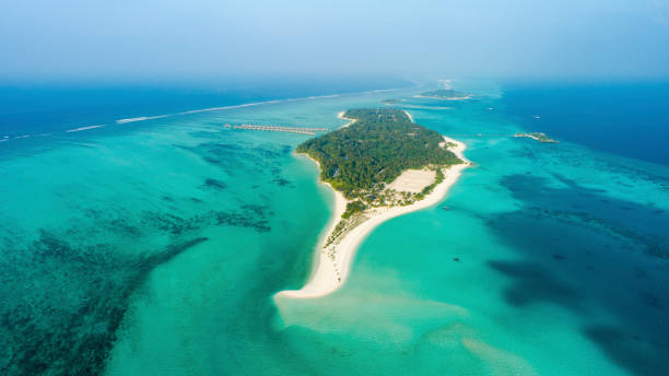 Aerial view of tropical island surrounded by vast ocean,Maldives stock photo