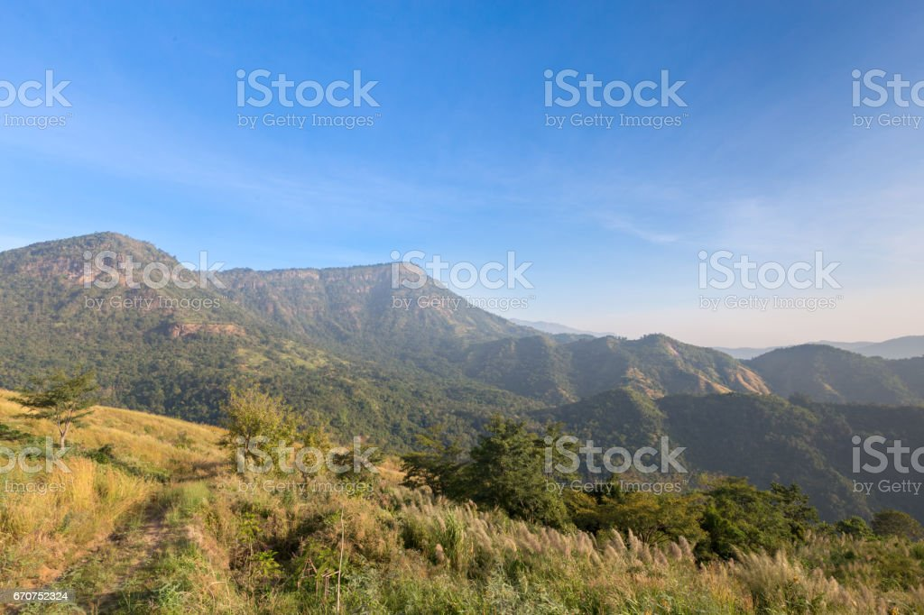 Aerial view of tropical mountain and cloudy sky. stock photo