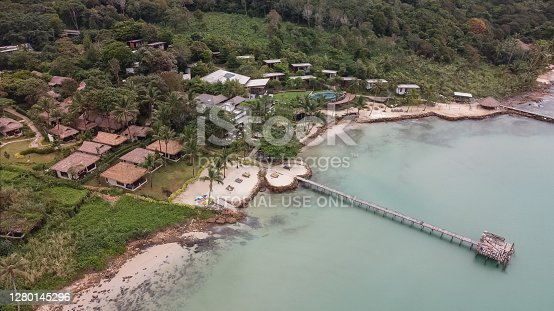 6 oct 20, Koh Kut Island, Thailand. aerial view of tropical resort and wooden jetty bridge on turquoise sea.