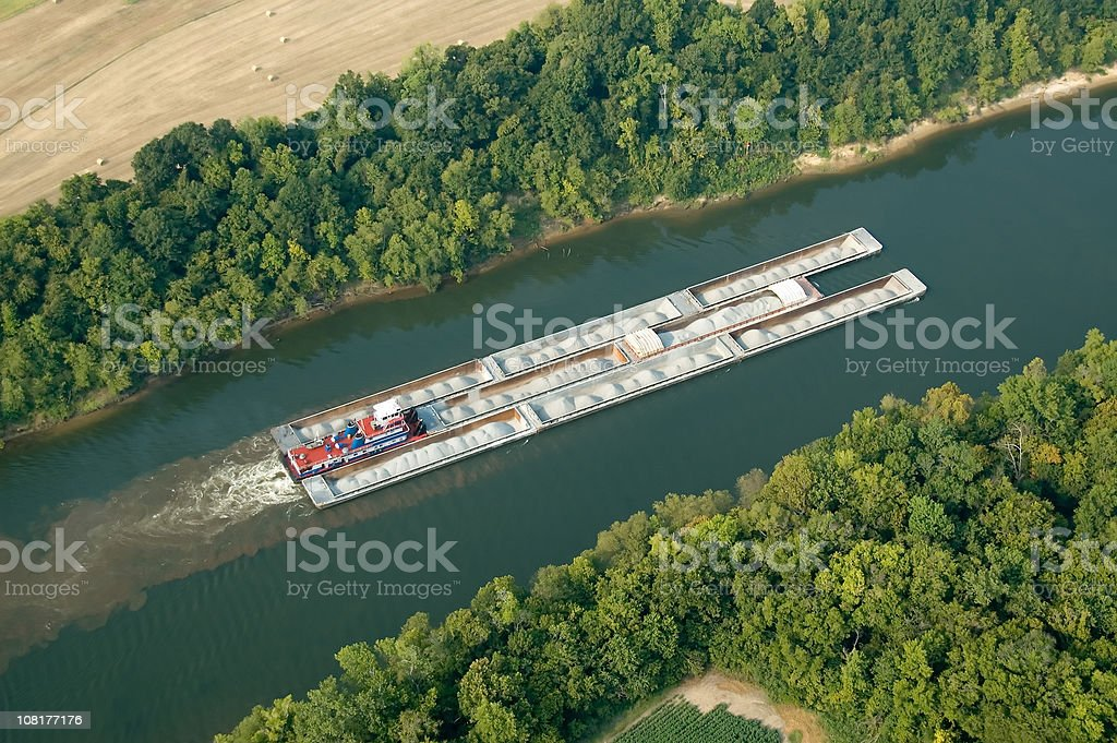 Aerial view of Tug and barges carrying gravel stock photo