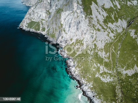 Drone photo of beautiful remote textured water beach in Northern Norway