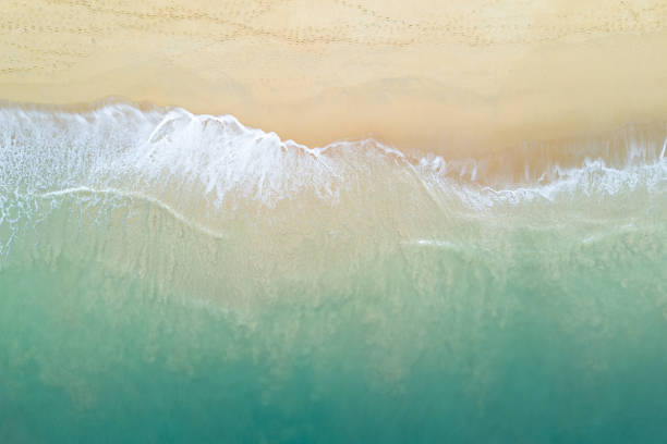 Aerial view of turquoise ocean wave reaching the coastline beautiful picture id1149576047?b=1&k=6&m=1149576047&s=612x612&w=0&h=pxe08enr2zd0idwoqvesm53olbww1cdtmtzp2ittvxg=
