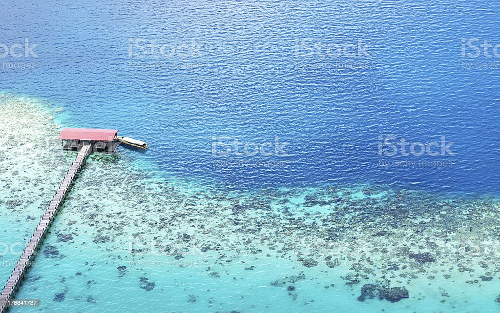 Aerial View of turquoise sea with Jetty in Bohey Dulang royalty-free stock photo