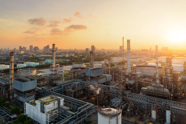 aerial view of twilight of oil refinery ,shot from drone of oil refinery plant ,refinery petrochemical plant at dusk , bangkok, thailand - industry stock pictures, royalty-free photos & images