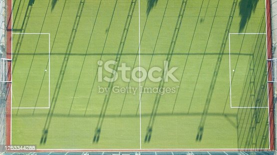 931661614 istock photo Aerial view of two football field. The field is empty and there are no people. 1253344288