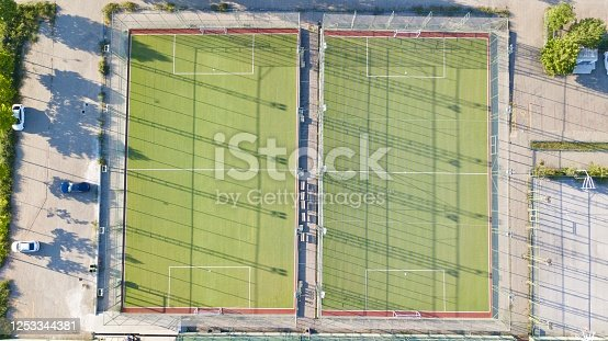 931661614 istock photo Aerial view of two football field. The field is empty and there are no people. 1253344381