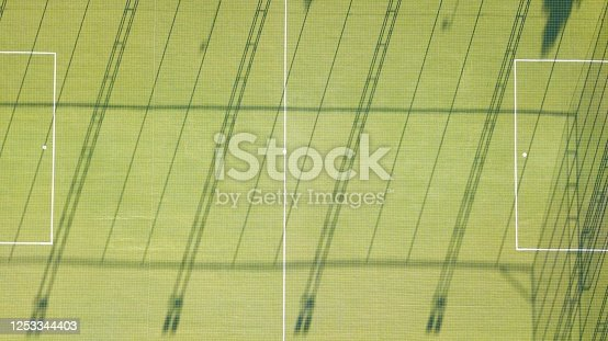 931661614 istock photo Aerial view of two football field. The field is empty and there are no people. 1253344403