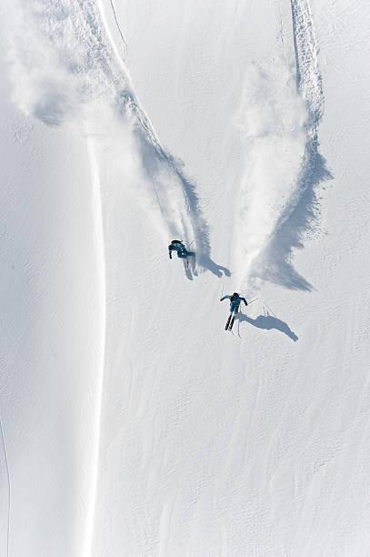 Aerial view of two skiers skiing downhill in powder snow picture id157590180?b=1&k=6&m=157590180&s=612x612&w=0&h=tvg8cjxftytdqaz3e2gaivu 89j6vicnh46hts8a2jk=