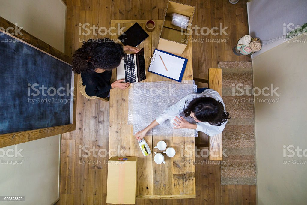 Aerial view of two women working stock photo