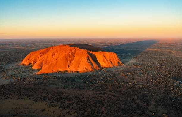 Aerial View Of Uluru In The Evening Sun stock photo