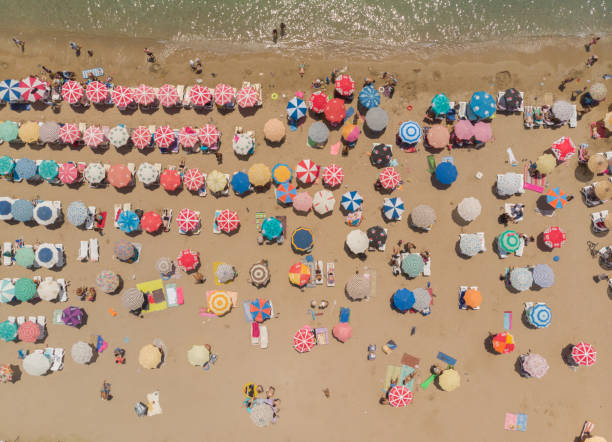 Aerial View of Umbrellas in a Beach of Aegean Sea stock photo