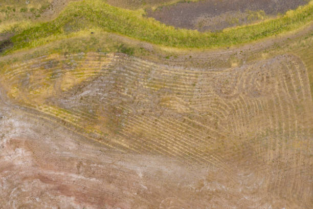 Aerial view of unusual markings in the ground near a water reservoir stock photo