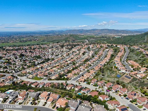 Aerial view of upper middle class neighborhood with residential subdivision houses during sunny day in San Diego, California, USA.
