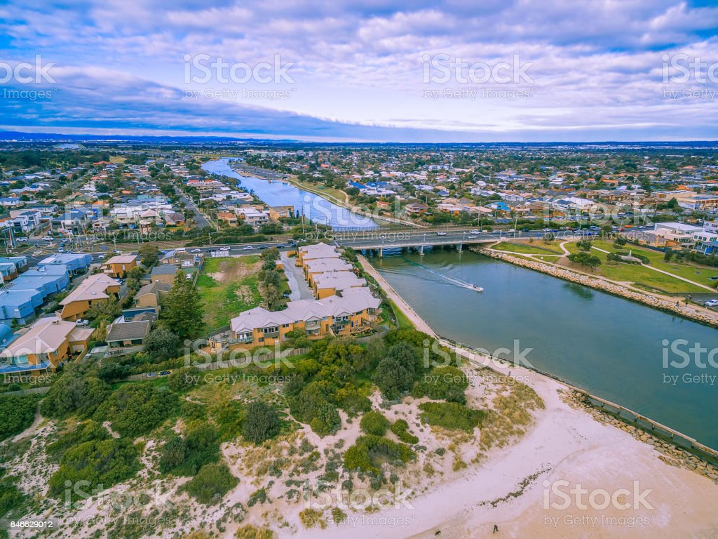 Aerial view of urban area and bridge across river stock photo