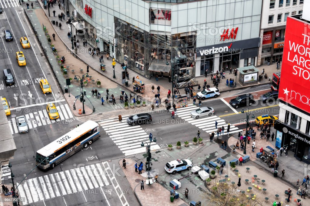 e51f39df5f17a Aerial view of urban building in NYC Herald Square Midtown with bus  turning