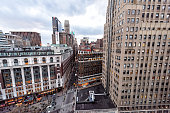 New York City, USA - April 6, 2018: Aerial view of urban cityscape, skyline, rooftop building windows, skyscrapers in NYC Herald Square Midtown with Macy's store, construction