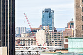 New York City, USA - April 7, 2018: Aerial view of urban street from rooftop building in NYC Herald Square Midtown with red construction crane skyscrapers